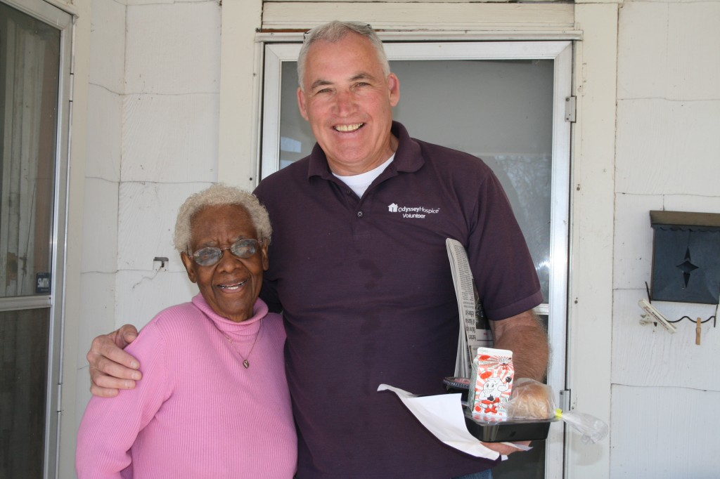 volunteer delivers meal